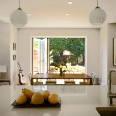 Contemporary Dining Room by Hoi Ning Wong