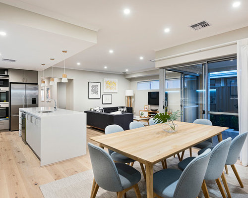 Design ideas for a scandinavian open plan dining room in perth with grey walls and light