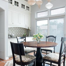 Traditional Dining Room by CAROLINE INC