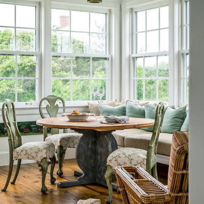 Inspiration for a coastal medium tone wood floor kitchen/dining room combo remodel in New York with white walls