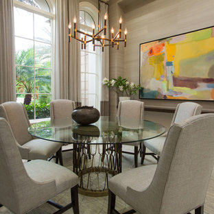 Inspiration for a large transitional limestone floor and beige floor enclosed dining room remodel in Tampa with gray walls
