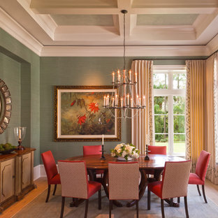 Enclosed dining room - traditional medium tone wood floor enclosed dining room idea in Boston with green walls and no fireplace