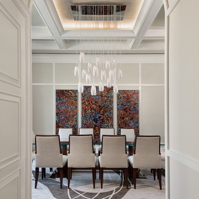 Enclosed dining room - large transitional medium tone wood floor and brown floor enclosed dining room idea in Miami with beige walls