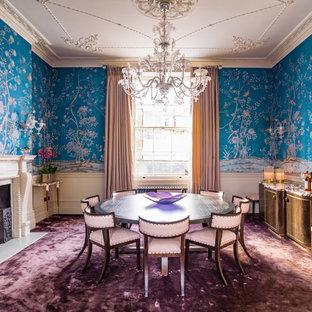Imagen de comedor clásico, grande, con paredes azules, moqueta, chimenea tradicional, marco de chimenea de piedra y suelo violeta