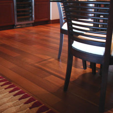 tropical dining room by Plantation Hardwood Floors