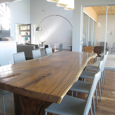 Trendy dining room photo in Dallas with white walls