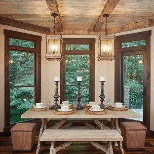 Foto de comedor rústico con paredes beige, suelo de madera oscura y suelo marrón