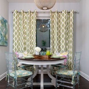 Example of an eclectic dark wood floor dining room design in Miami with gray walls