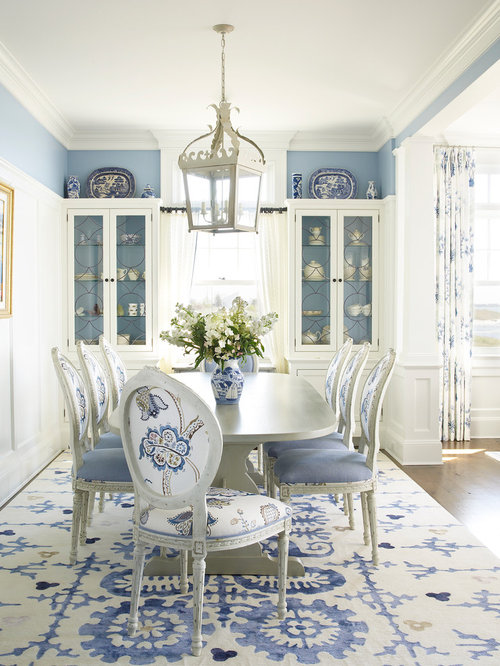 example of a coastal dining room design in new york with blue walls and dark hardwood - Country Dining Room Pictures