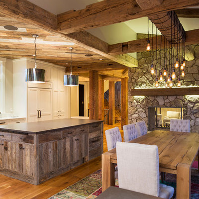 Kitchen/dining room combo - small country light wood floor kitchen/dining room combo idea in Minneapolis with beige walls and no fireplace