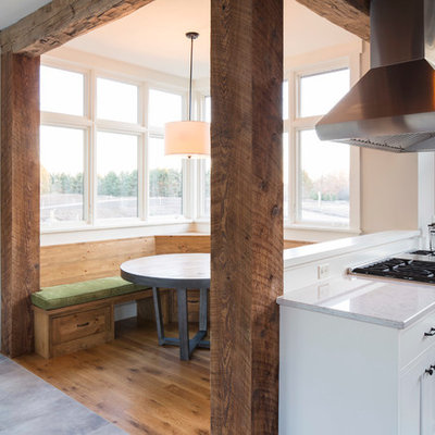 Kitchen/dining room combo - small cottage light wood floor kitchen/dining room combo idea in Minneapolis with beige walls and no fireplace