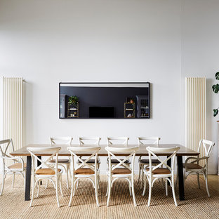 Photo of a contemporary open plan dining in Melbourne with white walls, no fireplace and beige floor.