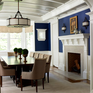 Large elegant medium tone wood floor enclosed dining room photo in New York with blue walls