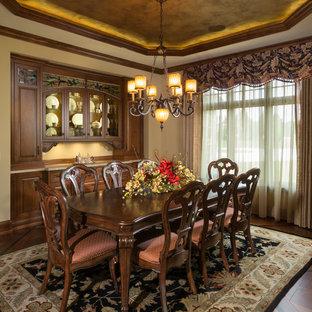 Elegant dark wood floor dining room photo in Milwaukee with beige walls