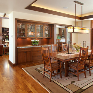 Example of a mid-sized arts and crafts medium tone wood floor great room design in San Diego with white walls