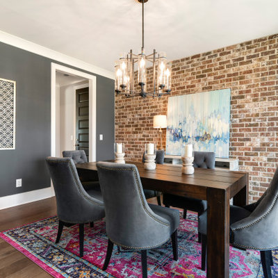 Inspiration for a transitional medium tone wood floor and brown floor enclosed dining room remodel in Nashville with gray walls and no fireplace