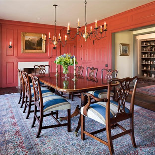 Inspiration for a farmhouse dark wood floor enclosed dining room remodel in Philadelphia with red walls