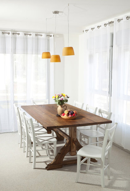 Rustic Dining Room by lilach shahaf