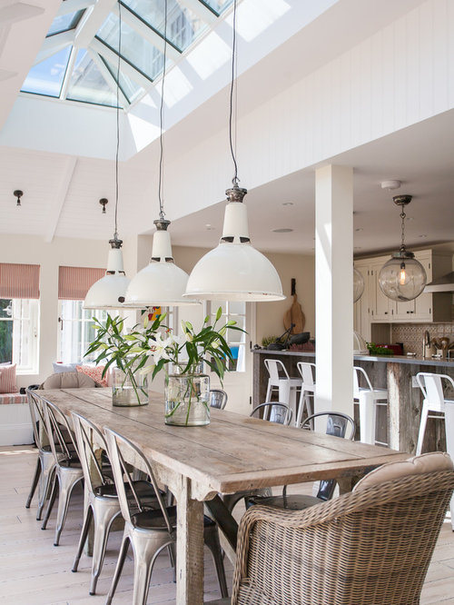 Large beach style dining room design ideas renovations for Beach themed dining room ideas