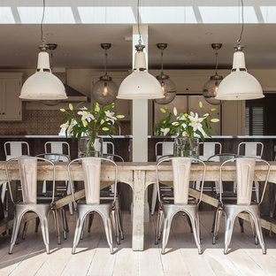 Inspiration for a shabby-chic style kitchen/dining combo in Sussex.