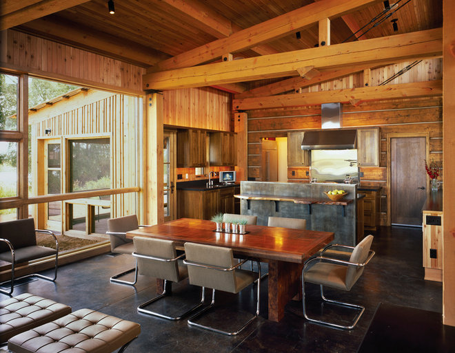 Rustic Dining Room by Carney Logan Burke Architects