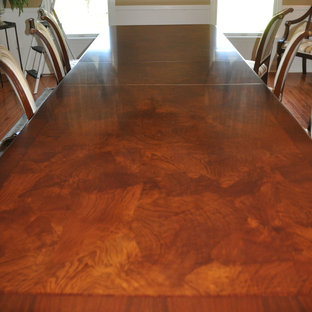 Example of a large classic medium tone wood floor dining room design in Newark with beige walls