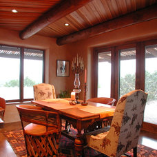 Traditional Dining Room by Confluence Architecture