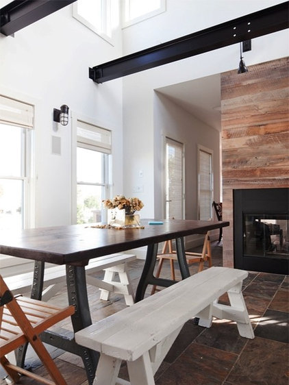 Industrial Dining Room by Richard Bubnowski Design LLC