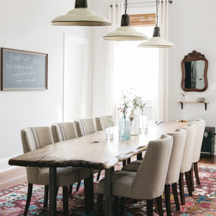 Example of a country enclosed dining room design in New Orleans with white walls