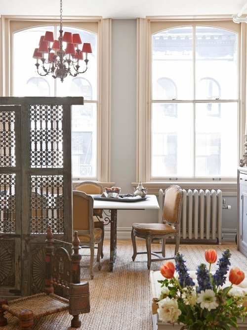Inspiration for a victorian dining room remodel in new york with gray