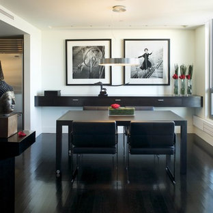 Inspiration for a mid-sized contemporary black floor and dark wood floor enclosed dining room remodel in Boston with white walls