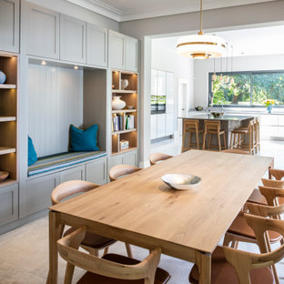 Large traditional kitchen/dining room in London with grey walls, concrete flooring and grey floors.