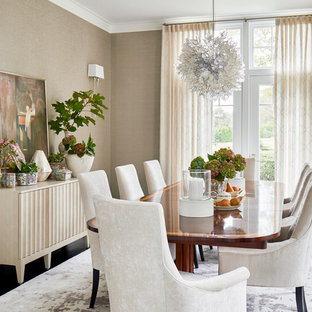 Example of a coastal dark wood floor and black floor dining room design in Providence with beige walls