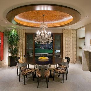 Cette image montre une grand salle à manger design fermée avec un manteau de cheminée en béton, béton au sol, un mur blanc, une cheminée standard et un sol beige.