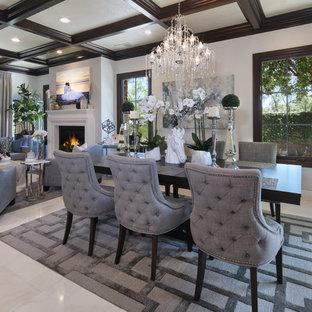 Immagine di una sala da pranzo aperta verso il soggiorno contemporanea di medie dimensioni con pareti bianche, pavimento con piastrelle in ceramica, camino classico, cornice del camino in legno e pavimento beige