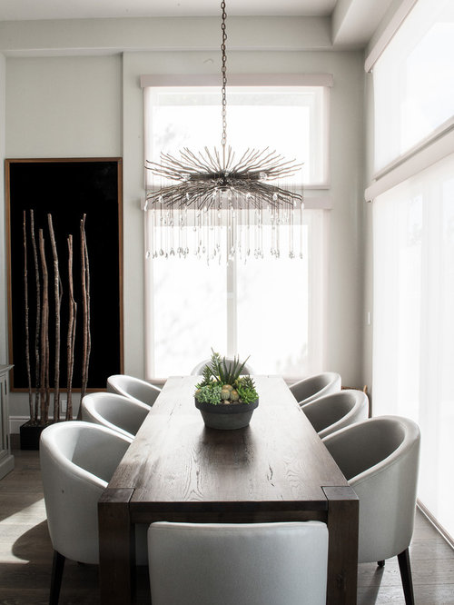 Example Of A Small Trendy Gray Floor And Medium Tone Wood Floor Dining Room  Design In