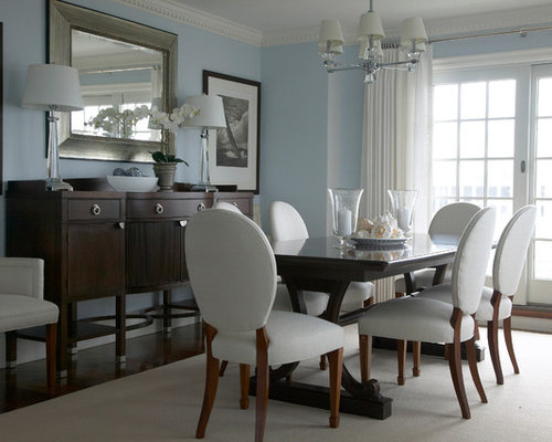 Example Of A Coastal Dark Wood Floor Dining Room Design In New York With Blue Walls