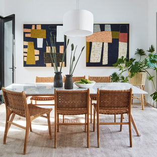 Inspiration for a contemporary dining room in Melbourne with white walls, light hardwood floors and no fireplace.