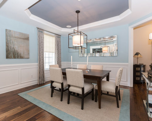 Example Of A Large Classic Medium Tone Wood Floor And Brown Floor Enclosed Dining  Room Design