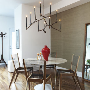Photo of a small contemporary open plan dining room in Toronto with medium hardwood flooring, brown walls, no fireplace and brown floors.