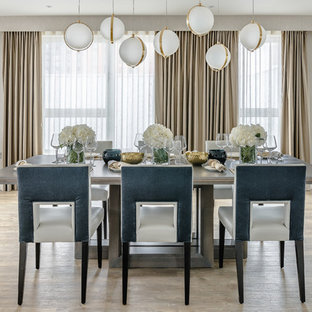 Inspiration for a medium sized contemporary open plan dining room in London with light hardwood flooring, no fireplace and beige walls.