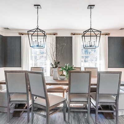 Example of a large transitional medium tone wood floor and brown floor enclosed dining room design in Newark with gray walls and no fireplace