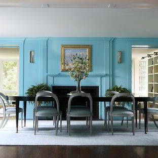 ニューヨークの大きいトランジショナルスタイルのおしゃれな独立型ダイニング (青い壁、濃色無垢フローリング、標準型暖炉、木材の暖炉まわり、茶色い床) の写真