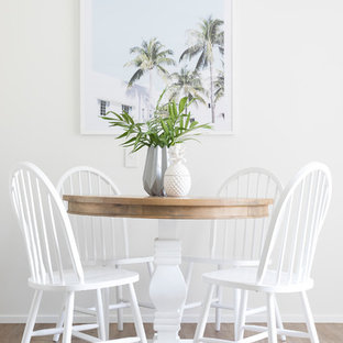 Design ideas for a contemporary dining room in Brisbane with white walls and light hardwood floors.
