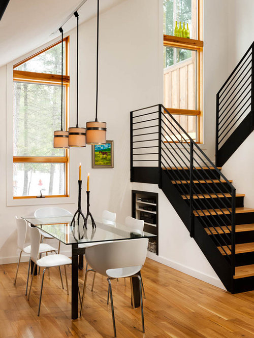 Small contemporary medium tone wood floor and brown floor kitchen/dining  room combo idea in