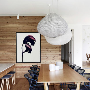 Inspiration for a contemporary open plan dining in Melbourne with brown walls, light hardwood floors and beige floor.