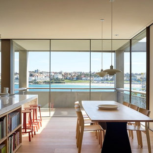Inspiration for a modern open plan dining in Sydney with light hardwood floors.
