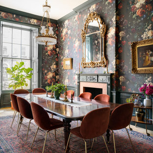 This is an example of a large traditional dining room in Edinburgh with multi-coloured walls, a standard fireplace, a tiled fireplace surround, beige floors and wallpapered walls.