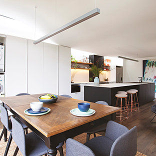 Mid-sized contemporary kitchen/dining combo in Melbourne with white walls, dark hardwood floors and brown floor.