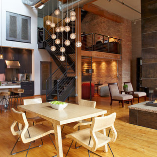 Inspiration for an industrial medium tone wood floor and brown floor great room remodel in Minneapolis with white walls, a two-sided fireplace and a tile fireplace